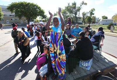 Nine-year-old Fatuma Mhamud claps while standing on a float during Saturday's event.
