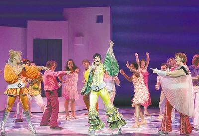 Joan Marcus photoDancing queen Kaye Tuckerman, centre, plays a red hot mama in the feel-good stage musical Mamma Mia!