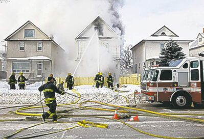 Firefighters battle blaze on Monday.