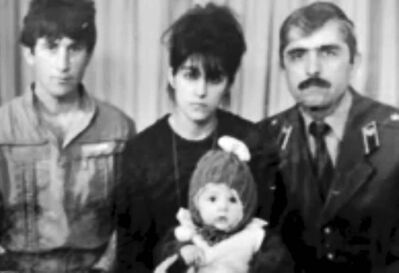 In this image taken from a video, an undated family photo provided by Patimat Suleimanova, the aunt of Boston bombing suspects, shows Anzor Tsarnaev left, Zubeidat Tsarnaeva holding Tamerlan Tsarnaev and Anzor�s brother, Mukhammad Tsarnaev. Now known as the angry and grieving mother of the Boston Marathon bombing suspects, Zubeidat Tsarnaev is drawing increased attention after federal officials say Russian authorities intercepted her phone calls, including one in which she vaguely discussed jihad with her elder son. In another, she was recorded talking to someone in southern Russia who is under FBI investigation in an unrelated case, U.S. officials said.
