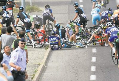 Stephane Mantey / L�Equipe / the associated pressAlberto Contador of Spain (91) sits on the road after a group of riders crashed during the first stage of the Tour de France (above). German rider Marcel Kittel emerged unscathed to win the first stage (right).