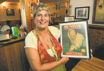 Tracey Konopada, owner of Luda�s Deli on Aberdeen Avenue, holds a picture of the original Eddy � her father �  Eddy Koranicki.