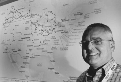 Bison�s Garth Pitzel next to the computerized map that shows the locations of the company�s entire fleet.