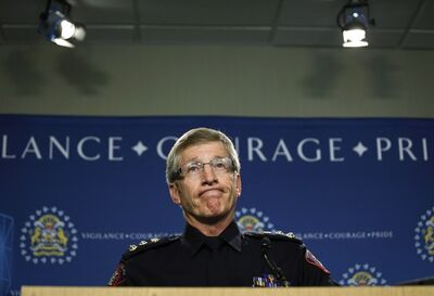 Calgary Police Chief Rick Hanson says first and second degree murder charges are being filed in connection with the disappearance of Nathan O'Brien and his grandparents at a news conference in Calgary, Alta., Monday, July 14, 2014. THE CANADIAN PRESS/Jeff McIntosh