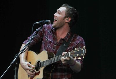 Phillip Phillips performs during a concert at Cynthia Woods Mitchell Pavilion in July in the Woodlands, Texas.
