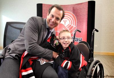 Hollywood actor Will Arnett shakes hands with 12-year-old Skyler Pearson, Dream Seats recipient at he United Way Tuesday.  Arnett helped the United Way launch a new program to help kids who might not otherwise get the chance to attend a Winnipeg Jets hockey game by donating his tickets.