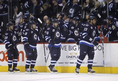 The Winnipeg Jets celebrate a first period goal against the Washington Capitals by Andrew Ladd at MTS Centre, Friday, March 16, 2012.