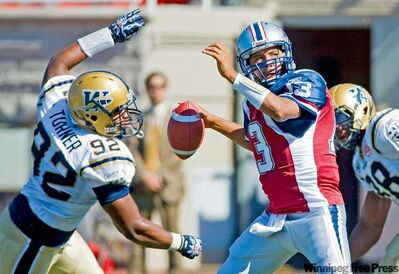 The Bombers kept Als pivot Anthony Calvillo to just 258 yards in the air. Here, DT Bryant Turner puts the heat on AC.