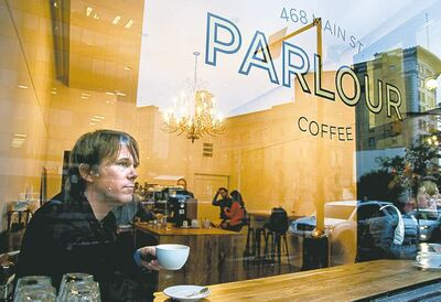 The Winnipeg Symphony Orchestra's Alexander Mickelthwate enjoys a brew at Parlour Coffee.