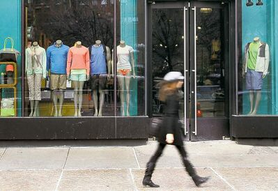 Mary Altaffer / The Associated PressA pedestrian walks past a Lululemon Athletica. The company said it�s recalling some of its yoga pants because they are see-through.