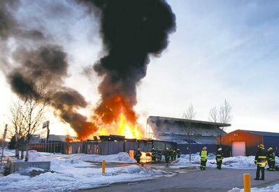 Flames shoot from a shed near Canad Inns Stadium.