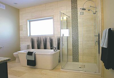 The ensuite features a gorgeous free-standing soaker tub.
