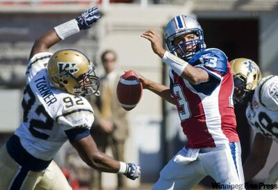 Montreal Alouettes quarterback Anthony Calvillo (13) is under pressure from the Blue Bombers' Bryant Turner (92) during first-half CFL football action in Montreal on Sunday. The Bombers won 25-23.