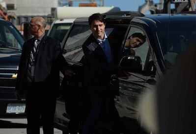 Prime minister-designate Justin Trudeau enters his car after taking a tour of the West Block construction site on Parliament Hill in Ottawa on Tuesday.