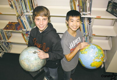 Brendan Yeryk (left) and Kevin Huynh were featured by the Manitoba Council for International Cooperation for their work spreading awareness in their school.