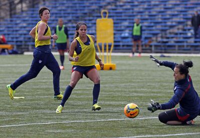 American goalkeeper Jill Loydon stops a Sydney Laroux shot during a practice Monday as the United States national women's soccer team prepares to take on Canada at Investors Group Field Thursday.