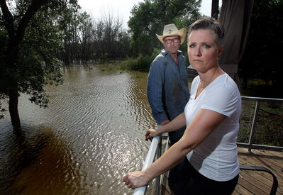 Laurie Wolfe and her husband, Brian, are sick of all the people driving past their St.Francois Xavier home to gawk at the flood preparations. They have made up a sign telling people who aren't there to help to keep on moving.