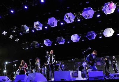 Arcade Fire perform during their headlining set on the third day of the 2014 Coachella Music and Arts Festival on Sunday, April 13, 2014, in Indio, Calif.