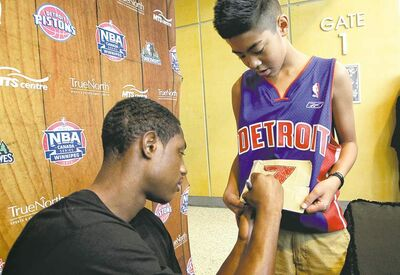 mike deal / winnipeg free pressPistons point guard Brandon Knight signs a jersey to which Justin Garcia, 13, taped Knight�s No. 7. Knight was here promoting the Oct. 24 exhibition game.