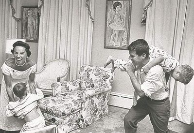 Ethel and Robert Kennedy playing with children at bedtime.