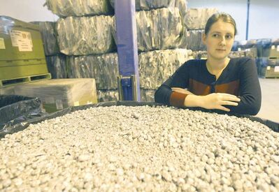 Marian Neumann  of Exner Technology�s with recycled aluminum from waste products- Morden, Manitoba-  See Kevin Rollason��s German FYI piece�� October 17, 2012   (JOE BRYKSA / WINNIPEG FREE PRESS)