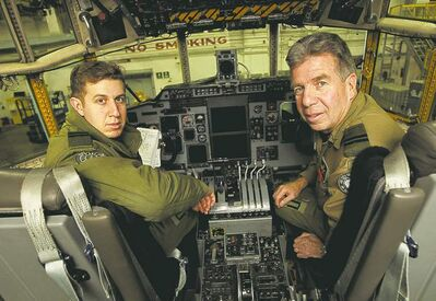 Mike Deal / Winnipeg Free Press Capt. Jonathan Pym and his father, Capt. Charlie Pym, inside the cockpit of a C-130 Hercules at Winnipeg's 17 Wing.