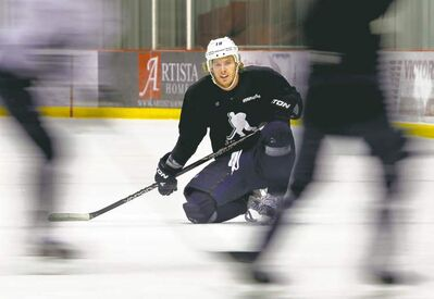WAYNE GLOWACKI / WINNIPEG FREE PRESS Winnipeg Jets centre Bryan Little waits for his shift during scrimmage as locked-out NHLers practise at the MTS Iceplex Thursday morning.