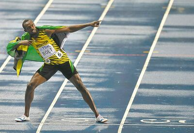 Usain Bolt celebrates his 100-m victory, but don't be surprised if lightning strikes a couple more times in Moscow.