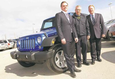 From left, Chris Kett, Chrysler Canada district manager, Keith Boyd, CancerCare Manitoba Foundation board member, and Steve Dennis, Prairie Chrysler Dealers Advertising Association.