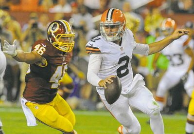 Washington Redskins inside linebacker Will Compton pursues Cleveland Browns rookie quarterback Johnny Manziel on Monday night.