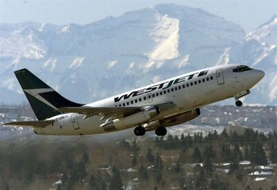 "A WestJet plane takes off from the international airport in Calgary, Thursday February 13, 2003. WestJet is reporting its ""best ever"" quarterly earnings. THE CANADIAN PRESS/Adrian Wyld"