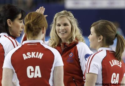 Team Canada skip Jennifer Jones (centre) celebrates with second Jill Officer (left), lead Dawn Askin and third Kaitlyn Lawes after defeating Saskatchewan in their playoff game at the 2011 Tournament of Hearts in Charlottetown on Friday.