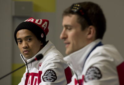 Canadian speed skater Gilmore Junio listens to Denny Morrison answer a question during a news conference at the Sochi Winter Olympics Sunday February 16, 2014 in Sochi, Russia. THE CANADIAN PRESS/Adrian Wyld