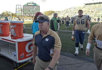Winnipeg Blue Bombers head coach TIm Burke leaves the field after a crushing 52-0 defeat at the hands of the Saskatchewan Roughriders in Regina, Sunday.