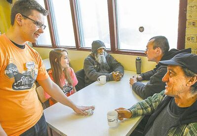 Students Checed Picklyk and Elizabeth Truijen visit with Zahir Jivrej (from left), Larry Leclair and James Malyk.