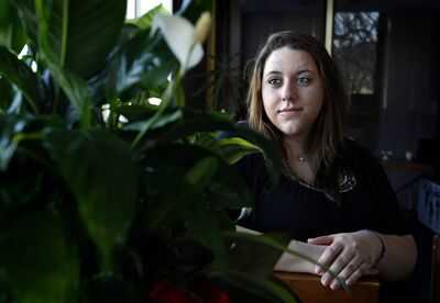 In this March 30, 2012, photo, Makenzie Emerson, 19, of East Islip, N.Y., poses for a photograph, at Daytop Suffolk Outreach center in Huntington Station, N.Y. Emerson had developed an addiction to pain killers and has recently completed treatment at the center. Sales of the nation's two most popular prescription painkillers have exploded in new parts of the country, an Associated Press analysis shows, worrying experts who say the push to relieve patients' suffering is spawning an addiction epidemic. From New York's Staten Island to Santa Fe, N.M., Drug Enforcement Administration figures show dramatic rises between 2000 and 2010 in the distribution of oxycodone, the key ingredient in OxyContin, Percocet and Percodan. (AP Photo/John Dunn)