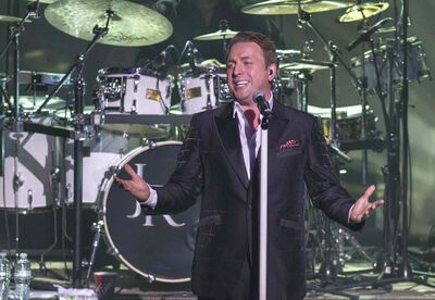 Johnny Reid performs with his band at the Centennial Concert Hall Monday night, part of a cross-country tour in support of his second yuletide album.
