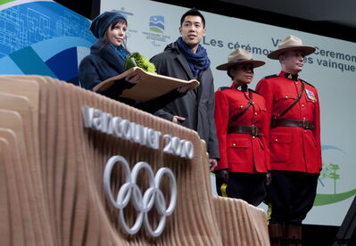 Organizers of the 2010 Winter Olympics unveiled the costumes for medal present­ers and flower bearers Tuesday in Vancouver. Own the Podium boss Roger Jackson says Canada will be a contender, just not in the early events.