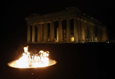 The Olympic Flame burns in the cauldron in front of Parthenon temple atop of the Acropolis Hill in Athens, Friday, Oct. 4, 2013. The flame will be transported by torch relay to the Russian resort of Sochi, which will host the Feb. 7-23, 2014 Winter Olympics. The Greek leg of the relay covered around 1,250 miles ahead of the Saturday Oct. 5 handover ceremony in the Panathenian Stadium in Athens, venue of the first modern Olympics in 1896. (AP Photo/Thanassis Stavrakis)