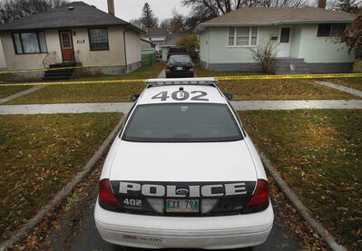 Winnipeg Police at the scene of two houses taped off in the 300 block of  Regent Ave. East near Roanoke St. after the stabbing on Oct. 19.