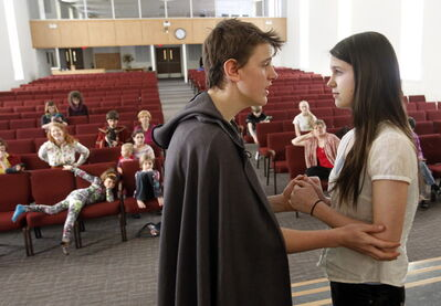 Home-schooled students Daniel McIntyre-Ridd and Maggie Gehman rehearse for the production of Shakespeare's Cymbeline. The cast includes 24 home-schooled students from 10 families.