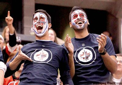 Jean Levac / postmedia newsFans of the Winnipeg Jets have fun during first-period NHL action in Ottawa Thursday.