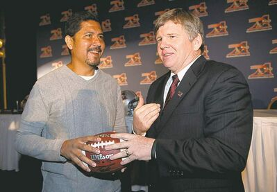GRAHAM HUGHES / THE CANADIAN PRESSAls quarterback Anthony Calvillo (left) chats with new coach Dan Hawkins Tuesday.