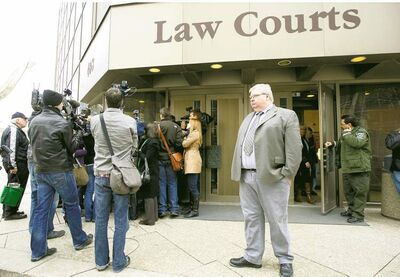 Alone on the courthouse steps as media talk to his lawyer Tim Killeen, Mark Stobbe walks away from the Winnipeg courthouse a free man March 29, 2012.