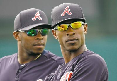 David J. Phillip / The Associated Press archivesBROTHERLY LOVE: The pairing of brothers Justin (left) and B.J. Upton in Atlanta almost didn�t happen, as Justin was nearly traded from Arizona to Seattle before the deal that sent him to Georgia.