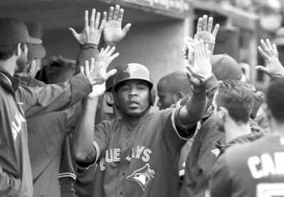 Paul Sancya / the associated pressToronto's Edwin Encarnacion (centre) celebrates in the dugout after scoring on Mark DeRosa's two-run double in the sixth inning at Comerica Park Wednesday.