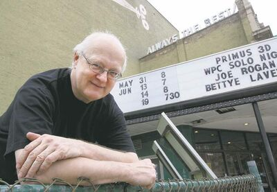 Godwin,  in front of the Burton Cummings Theatre, was  bitten by  the movie bug shortly after  moving  to Manitoba  in the '70s.