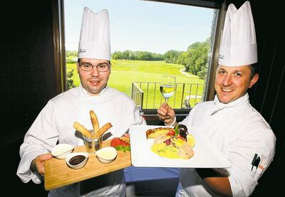 Photos by Boris Minkevich / Winnipeg Free PressSous chef Justin Brown, left, and executive chef Cameron Huley with a view of the greens;
