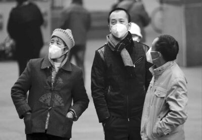 People wear smog-protecting masks in Shanghai, China, on Dec. 9.