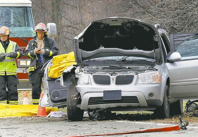 Firefighters attend the fatal Wellington Crescent crash on Nov. 1, 2012.